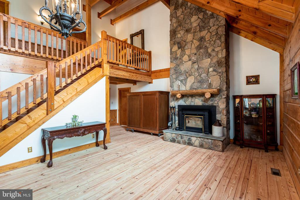 Soaring stone fireplace welcomes you to great room - 33150 HUMMINGBIRD LN, LOCUST GROVE