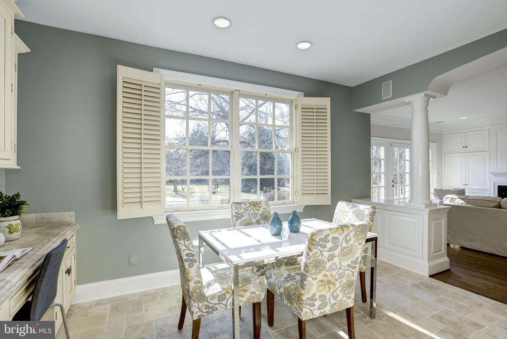 plantation shutters at sunny dining area - 3818 N RANDOLPH CT, ARLINGTON