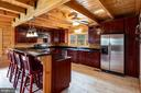 Cherry cabinetry, glistening granite countertops - 33150 HUMMINGBIRD LN, LOCUST GROVE