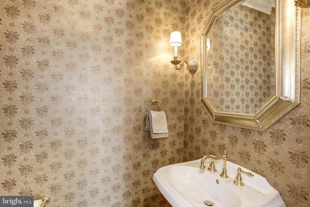 whimsical wallpaper illuminates the powder room - 3818 N RANDOLPH CT, ARLINGTON