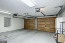 large 2 car garage lined with storage cabinets - 3818 N RANDOLPH CT, ARLINGTON