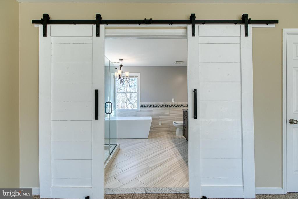 Barn doors to the master spa bathroom - 11 LINDSEY LN, STAFFORD