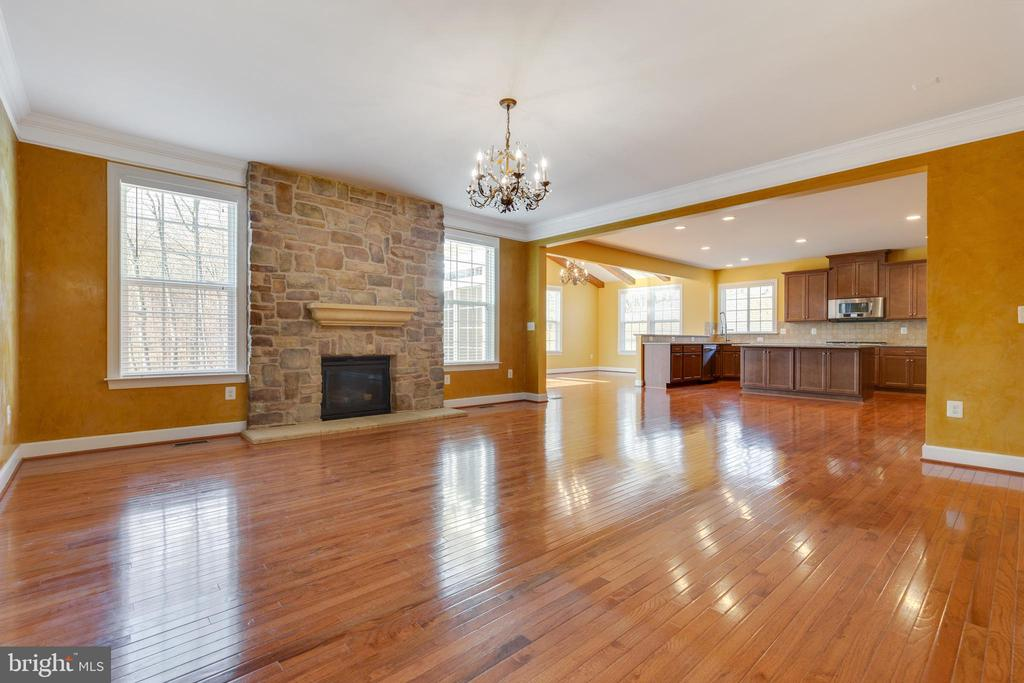 Spacious Family Room with Stone Gas Fireplace - 15879 FROST LEAF LN, LEESBURG