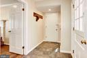 The first floor tiled mud room/laundry area. - 11726 WINTERWAY LN, FAIRFAX STATION