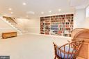Lower level recreation room w/ bookshelves. - 11726 WINTERWAY LN, FAIRFAX STATION