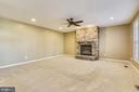Great room  w/ floor to ceiling stone fireplace. - 22128 PARK GLENN DR, BROADLANDS