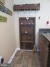 Custom door to under stairs storage - 10623 LEGACY LN, FAIRFAX