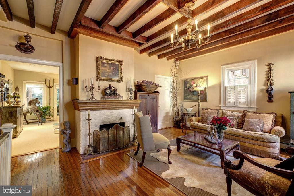 Living room with exposed antique beams. - 1423 36TH ST NW, WASHINGTON