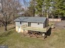 Back of House New Roof, Siding & Deck - 2129 FLAG MARSH RD, MOUNT AIRY