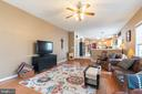 Family room with open floor plan to kitchen - 260 SPOTTED TAVERN RD, FREDERICKSBURG