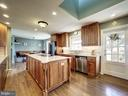 Kitchen and Adjacent Eating Area - 7800 PERSIMMON TREE LN, BETHESDA