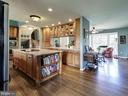 Kitchen with Center island - 7800 PERSIMMON TREE LN, BETHESDA