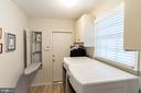 Main Level Laundry room with new washer and dryer. - 11905 VIEWCREST TER, SILVER SPRING
