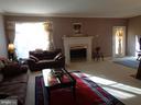 Living Room w/ Gas Fireplace & Door to Deck - 12509 HAWKS NEST LN, GERMANTOWN