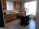 Kitchen w/ Ceramic Floor & Center Island Eating - 12509 HAWKS NEST LN, GERMANTOWN