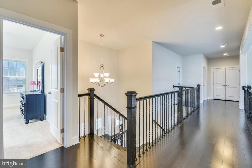 Hallway with wrought iron raining & wood floors - 41178 CHATHAM GREEN CIR, ALDIE