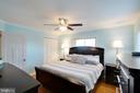 Master bedroom has hardwood floors and ceiling fan - 10822 CHARLES DR, FAIRFAX