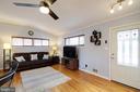 The living room has gleaming hardwood floors - 10822 CHARLES DR, FAIRFAX