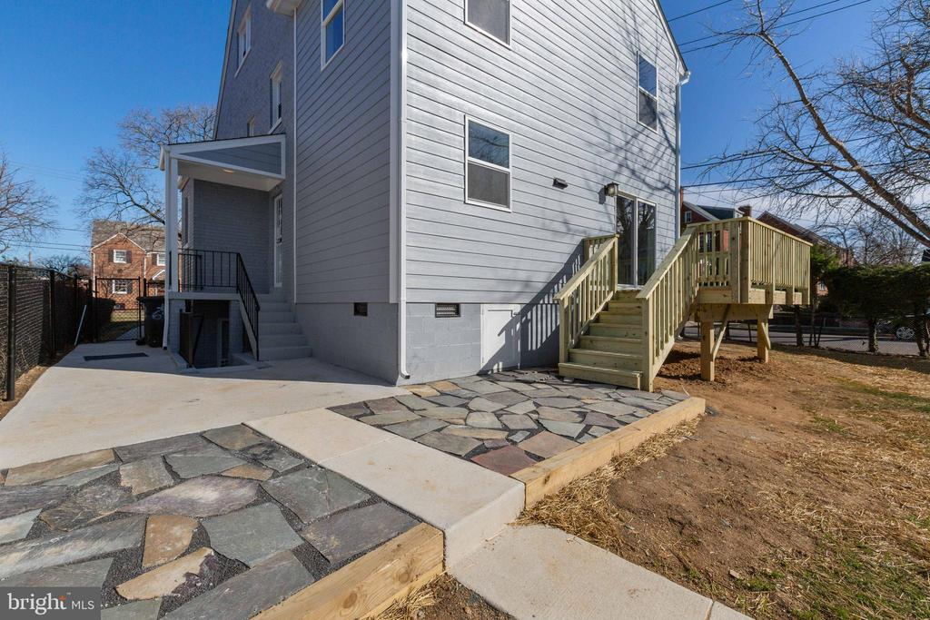 Your side view of slate patio and wood deck. - 6420 13TH ST NW, WASHINGTON