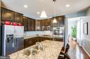 Granite, espresso cabinets, stainless steel - 75 COLEMANS MILL DR, FREDERICKSBURG
