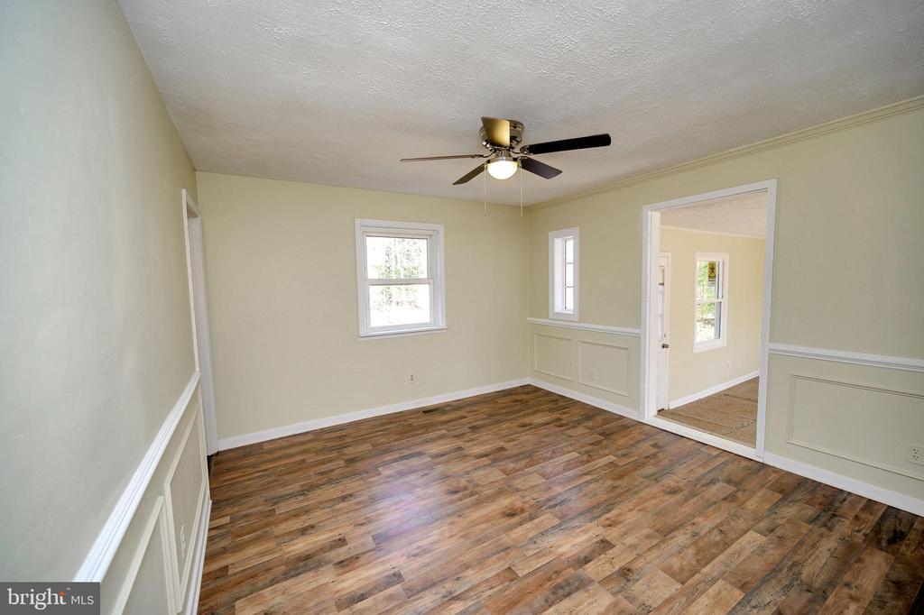 Master bedroom offers attached bonus room. - 7324 EMBREY DR, LOCUST GROVE