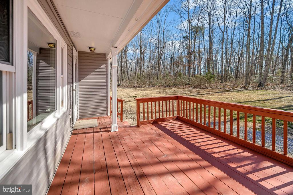Relax on your front porch. - 7324 EMBREY DR, LOCUST GROVE