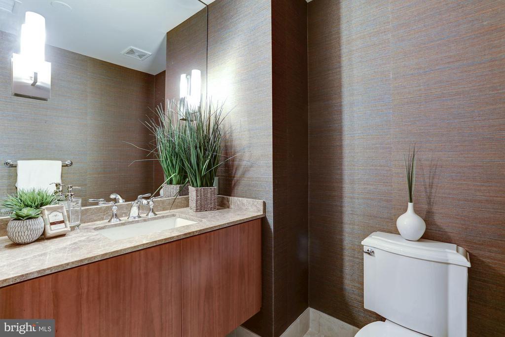Guest powder room offers modern textured walls - 2425 L ST NW #203, WASHINGTON