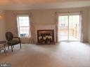 Formal living room with wood burning fireplace - 2550-B S ARLINGTON MILL DR #B, ARLINGTON
