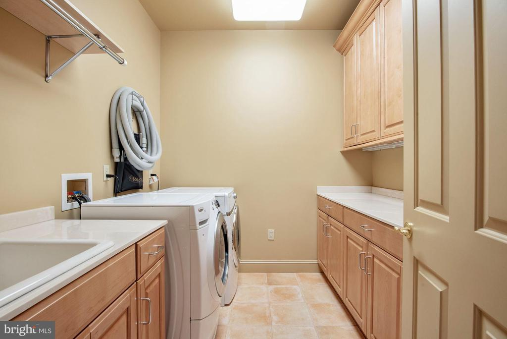 Upper Lvl Laundry w/Front Loading W/D and Cabinets - 896 ALVERMAR RIDGE DR, MCLEAN