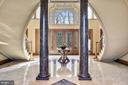 Extended Foyer and Dual Curved Stairs - 896 ALVERMAR RIDGE DR, MCLEAN