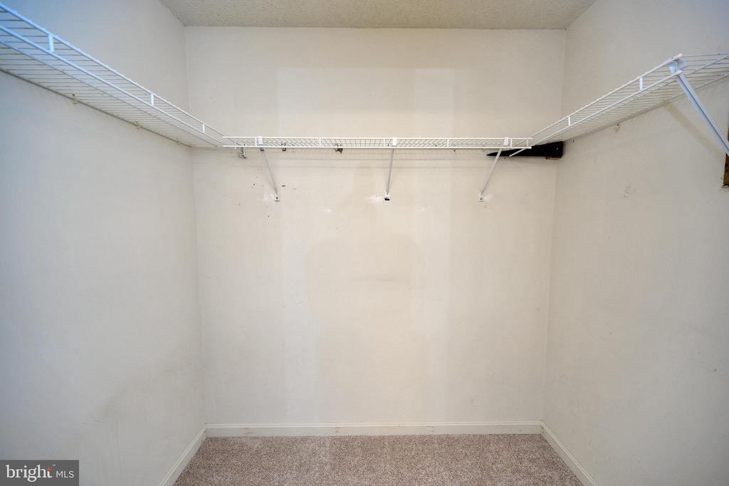 Ample space in this large walk in closet. - 327 BIRCHSIDE CIR, LOCUST GROVE