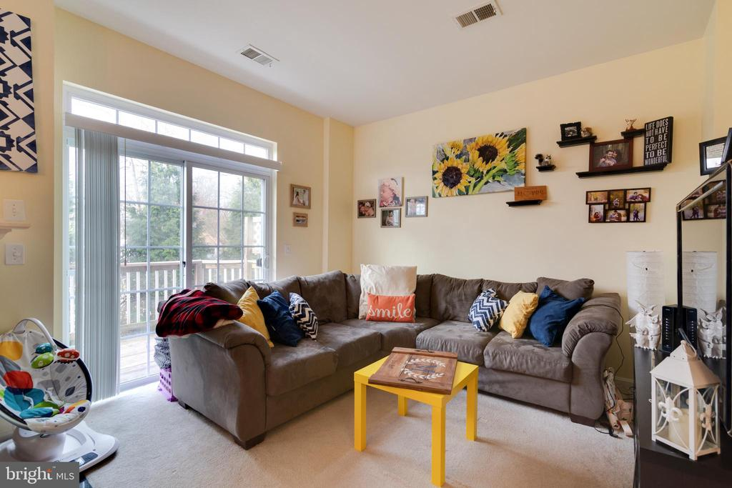 Spacious family room with sliding doors to deck - 13949 HOLLOW WIND WAY #201, WOODBRIDGE