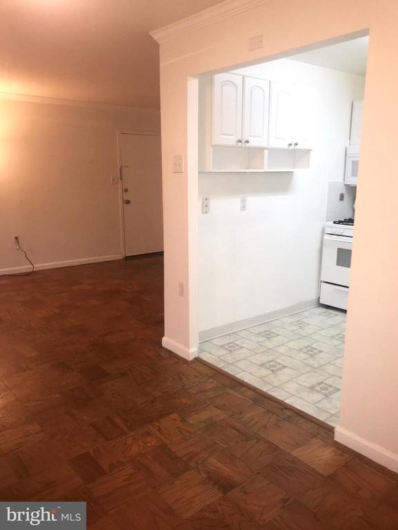 Dining room into kitchen and living room - 12309 BRAXFIELD CT #3, ROCKVILLE