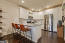 Gourmet Kitchen with Breakfast Bar - 23290 MILLTOWN KNOLL SQ #106, ASHBURN