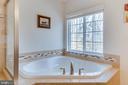 Corner Soaking Tub with Window - 3499 EAGLE RIDGE DR, WOODBRIDGE