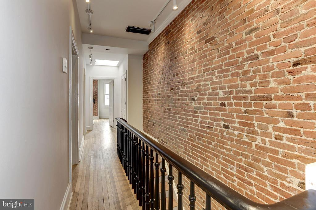 Exposed brick walls throughout - 1332 RIGGS ST NW, WASHINGTON