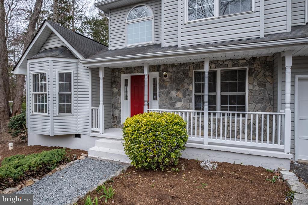 Front Door/Porch Exterior with Landscaping - 105 MUSKET LN, LOCUST GROVE