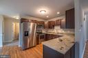 Kitchen with Stainless Steel Appliances - 105 MUSKET LN, LOCUST GROVE