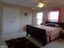 Master Bedroom w/ Double-door to Master Bath - 12509 HAWKS NEST LN, GERMANTOWN