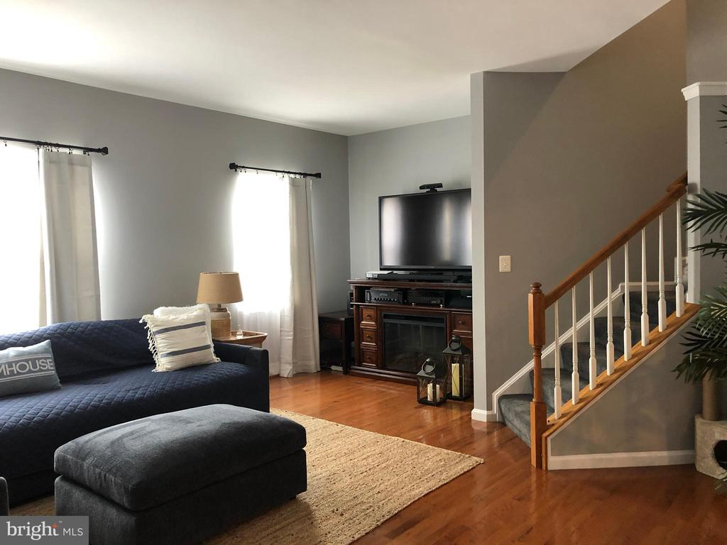 Living room with hardwood floors - 241 WOODSTREAM BLVD, STAFFORD