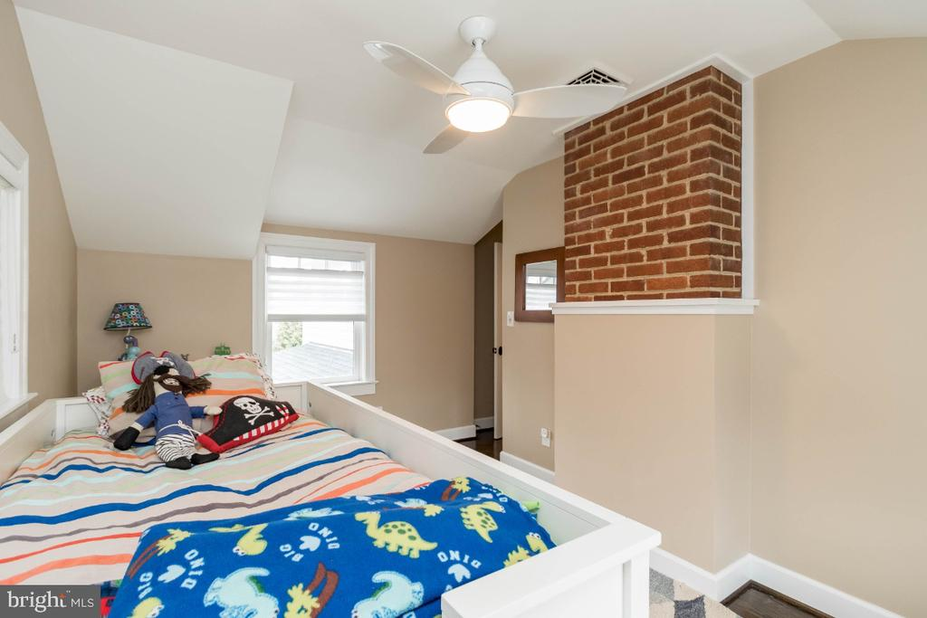 Bedroom 4 with exposed brick with built-ins - 6308 26TH ST N, ARLINGTON