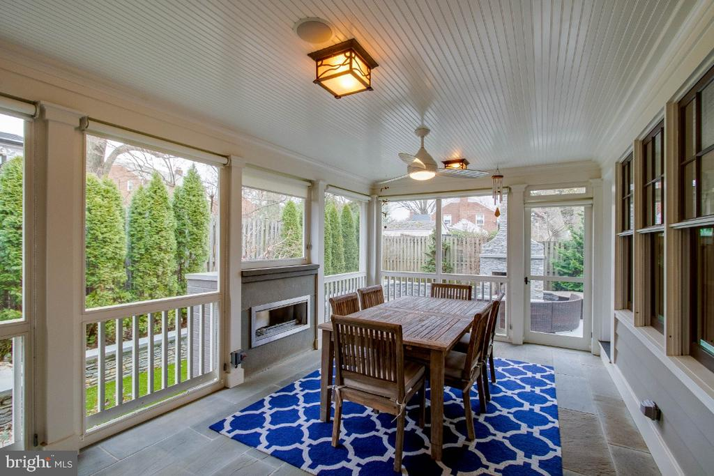 screen porch with gas fireplace - 6308 26TH ST N, ARLINGTON