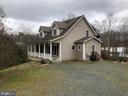 Covered front porch plus side entrance - 24186 LANDS END DR, ORANGE