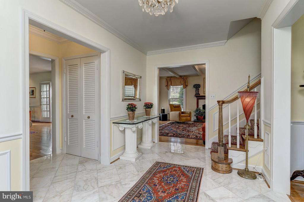 Open foyer to dining, living and family room - 7608 ARROWOOD RD, BETHESDA