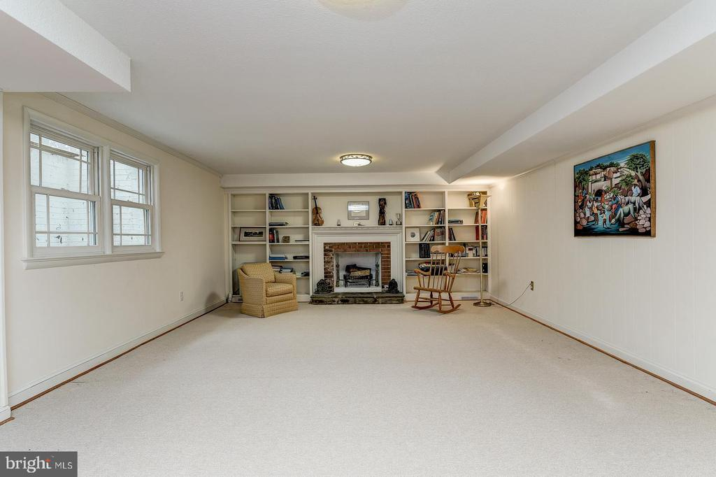 Family room in lower level with wood burning FP - 7608 ARROWOOD RD, BETHESDA