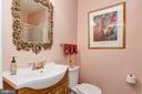 Full bathroom off of kitchen by laundry room - 7608 ARROWOOD RD, BETHESDA