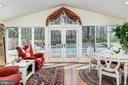 Great room with french doors leading to the pool - 7608 ARROWOOD RD, BETHESDA