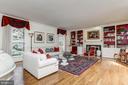 Living room with wood burning fireplac - 7608 ARROWOOD RD, BETHESDA