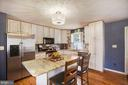 Granite and stainless in light filled kitchen! - 6765 BALMORAL RDG, NEW MARKET