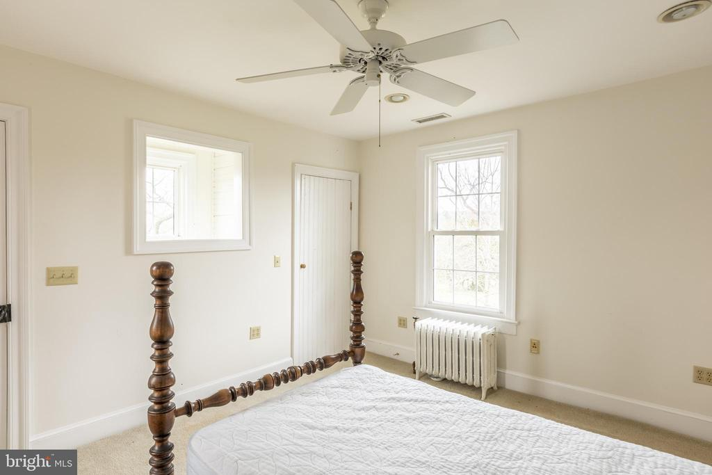 Bedroom # 4 with stairs leading to kitchen - 3374 TWYMANS MILL RD, ORANGE